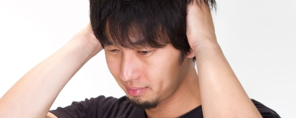 包茎が原因で病気になってしまい頭を抱える男性